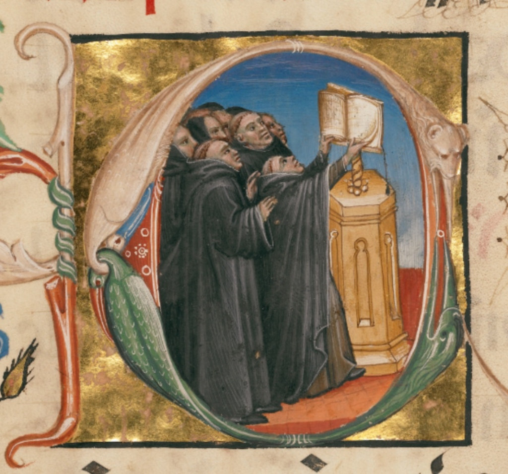 A medieval manuscript illumination of monks singing in front of a book.